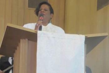 Rev. M preaching