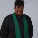Rev Moffett black robe